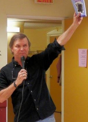 Randy Ray promoting Carl Dow's collection of short stories, The Old Man's Last Sauna, in 2013.