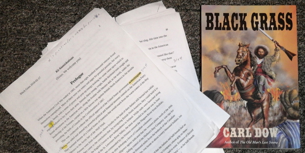 Photo showing marked-up manuscript and finished copy of Black Grass by Carl Dow